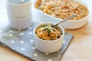 Roasted Cauliflower Mac and Cheese served to the table in a small bowl with spoon