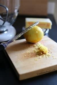 Getting lemon zest on a wooden board