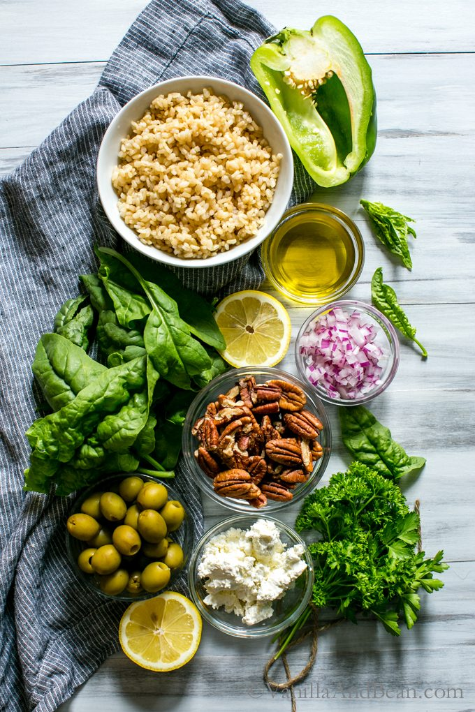 Overhead shot of the ingredients for Spinach Pecan Brown Rice Salad with Feta.