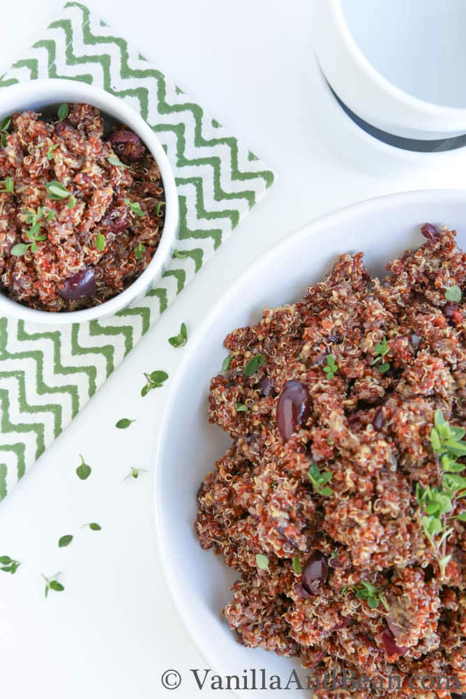 A small bowl and a serving bowl of roasted eggplant and quinoa salad