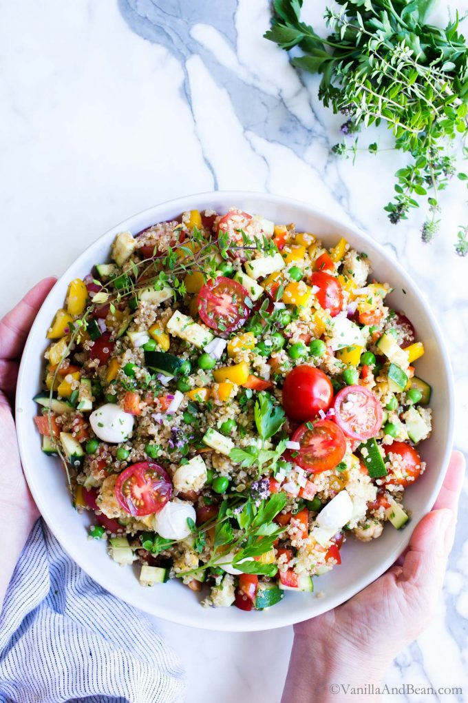 Overhead shot of vegetable quinoa salad ready for sharing.