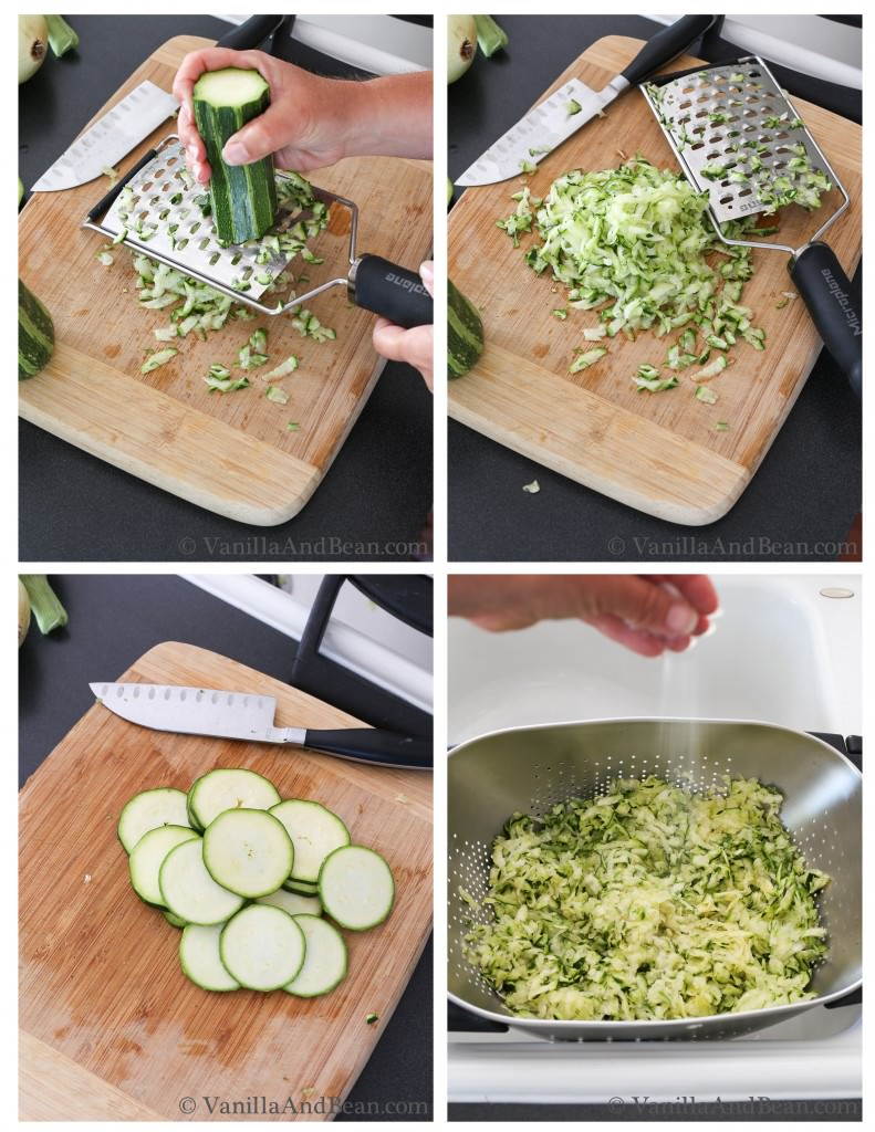 A zucchini is grated and transferred to a colander and salt is added. Another zucchini is sliced over a chopping board with a knife.