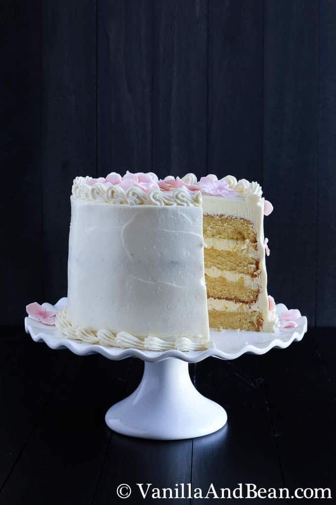 A fully-decorated decorated cake with a slice removed