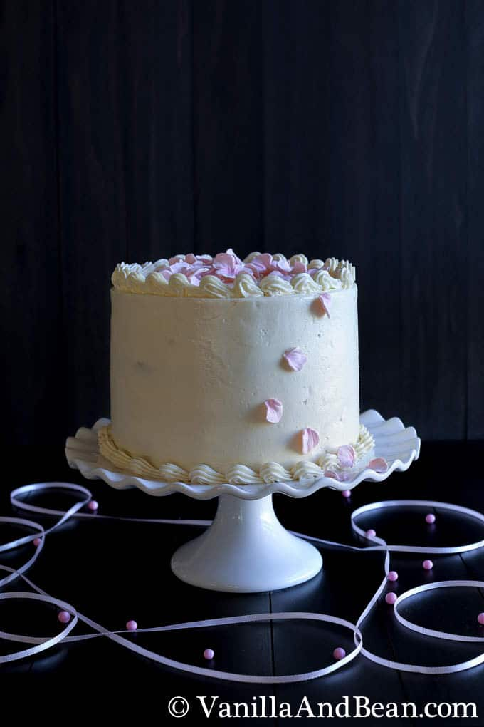 A layered cake on a decorative cake stand