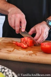 Cutting half the tomato into about 6 pieces