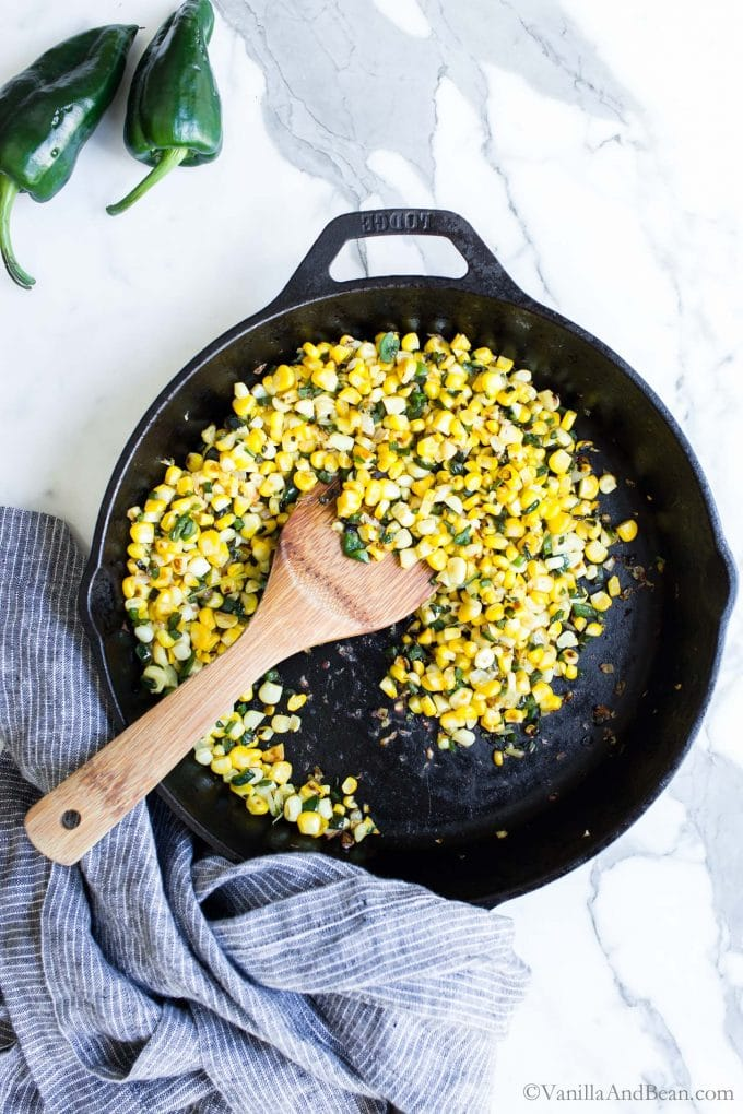 Corn, poblano peppers and onion in a skillet.