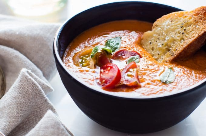 Hearty and rich withjust 5 ingredients in this Roasted Red Bell Pepper and Heirloom Tomato Soup. Freeze with ease to preserve for winter days ahead. #TomatoSoup #RoastedRedBellPepper #SoupSeason #GlutenFree #Vegan