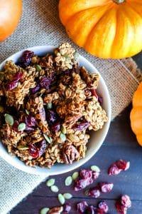 Healthy pumpkin granola in a small white bowl