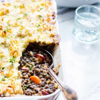 Warm, hearty, and comforting, this vegetarian Cottage Pie is packed with lentils, mushrooms, veggies and herbs. It feeds a small crowd and is a festive way to celebrate the holiday season or anytime a cozy meal is needed. |  #Vegetarian #Thanksgiving #VeganOption #GlutenFreeOption