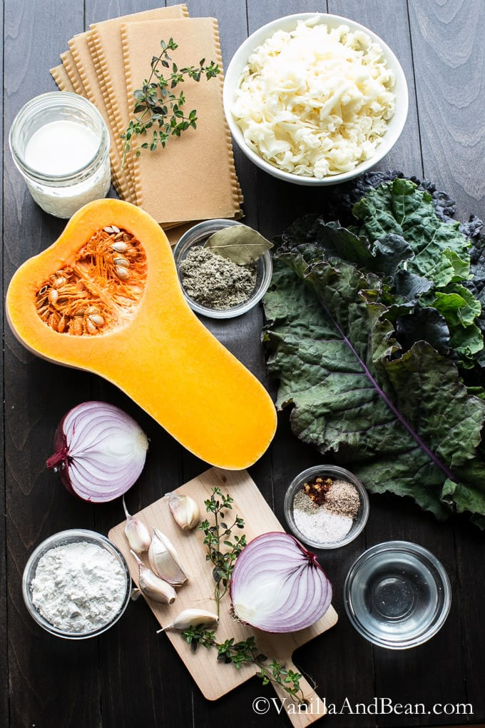 Ingredients for butternut squash and kale lasagna on a table