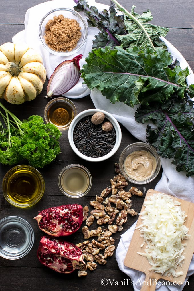 Squash, kale, walnuts and other ingredients on a table