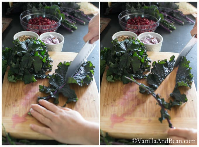 A kale destemmed on a chopping board with a knife