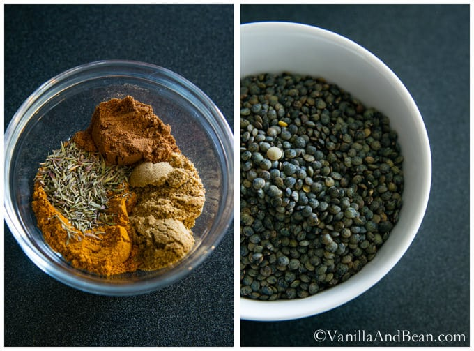 Spices in a small glass bowl and fresh green lentils in a bigger bowl.