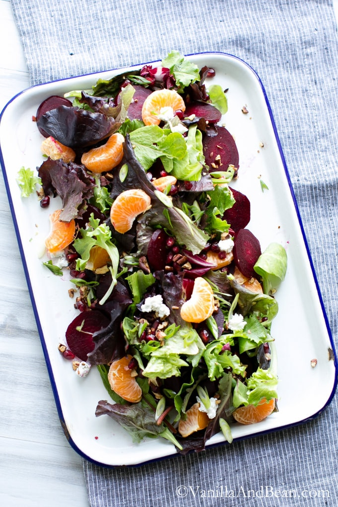 A tray of Winter Jeweled Salad with Citrus Balsamic Vinaigrette.