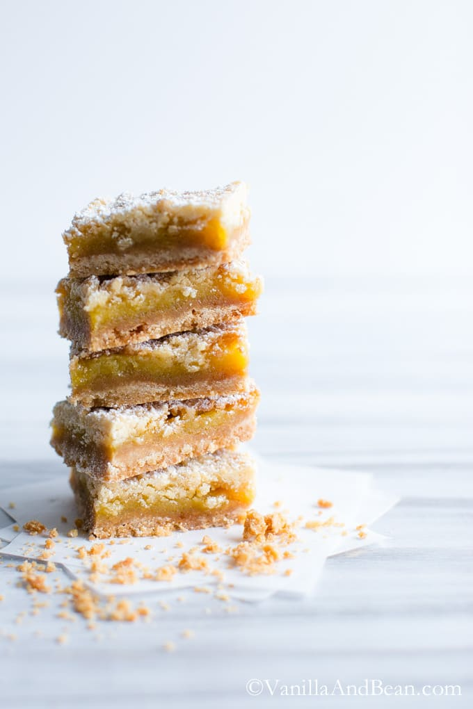 A layer of Orange Crumble Tart squares surrounded by a few crumbs.