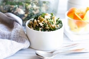 A small bowl of Farro, Kale and Olive Salad with Citrus Vinaigrette.