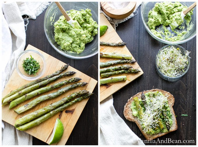 Asparagus on a chopping board surrounded by mashed avocado in a glass bowl, alfalfa sprouts in a small bowl, and a toast topped with those.