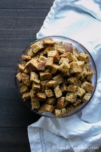 Coconut Oil Herbed Croutons filling a glass bowl to the full.