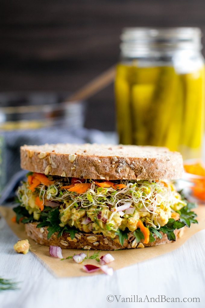 The Tangy Smashed Chickpea Salad Sandwich with dill and spicy mustard makes a delicious sandwich or salad for a week-day lunch, weekend picnic or potluck!