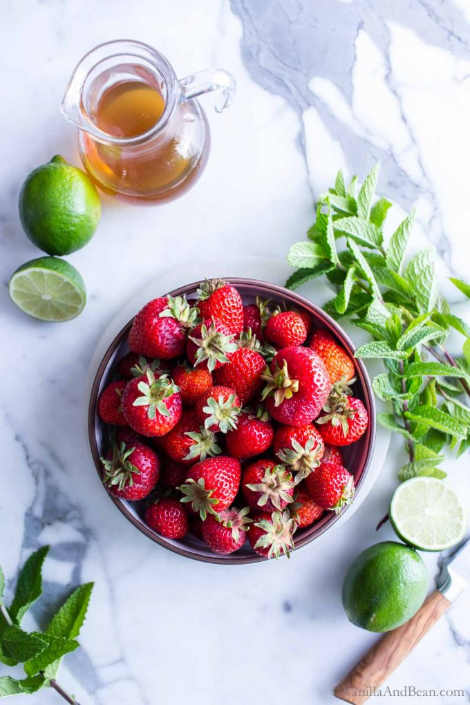 Overhead shot of strawberry mojito ingredients.