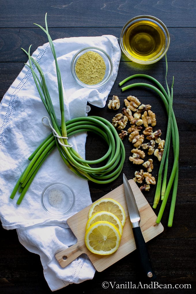 Ingredients for the Vegan Garlic Scape Pesto on a table.