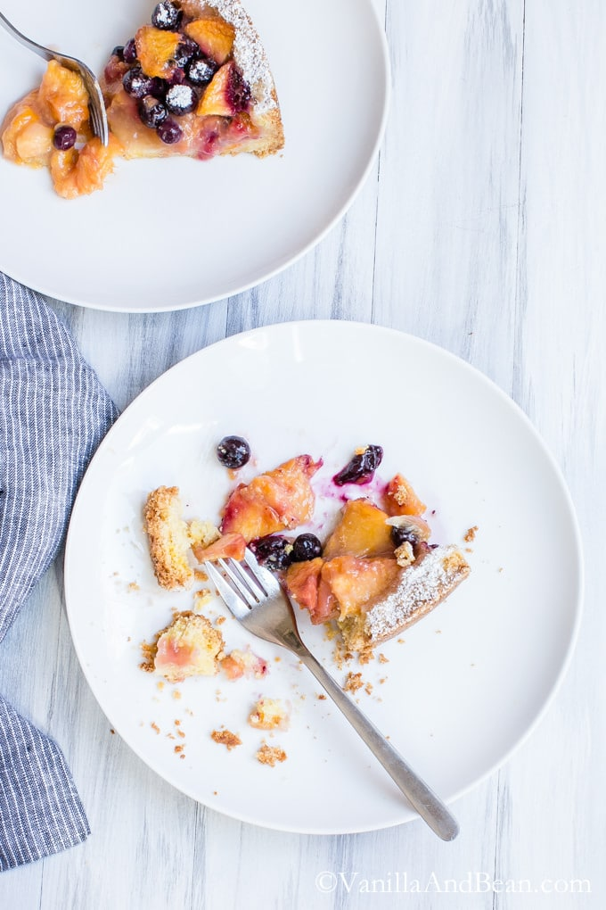 Blueberry Peach Cobbler-Tart on two plates with forks.