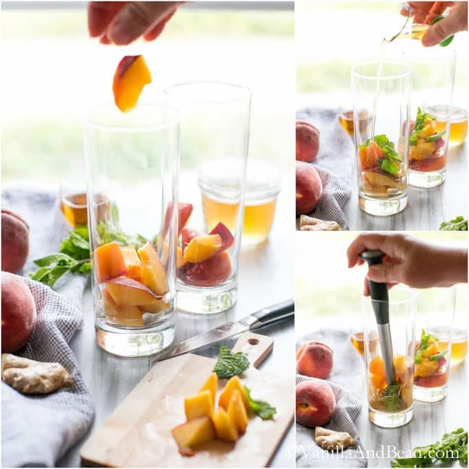 Pieces of peach, mint and simple syrup are added to two tall glasses and muddled with a steel muddler.