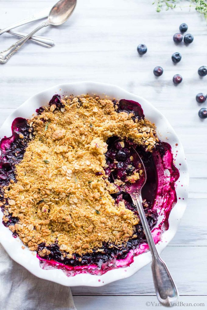 Overhead picture of Blueberry Cornmeal Crisp with a spoon in it.