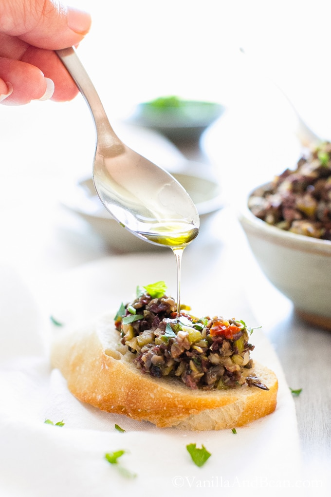 Olive Tapenade: A salty, garlicky, lemony snack, spread or appetizer. This olive tapenade recipe takes ten minutes and you're done! vegan + gluten free