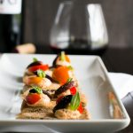 A fabulous, one bite appetizer | Roasted Garlic Sun-Dried Tomato Goat Cheese Canapé