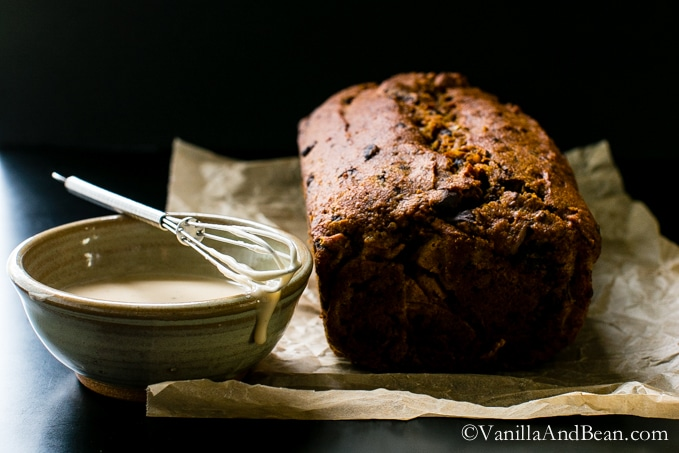 Chocolate and pecan studded pumpkin bread is Vegan and packed with ingredients like spelt flour, applesauce, coconut oil and a bit of brown sugar, finished with a maple glaze.| Pumpkin Chocolate Pecan Bread | Vanilla And Bean