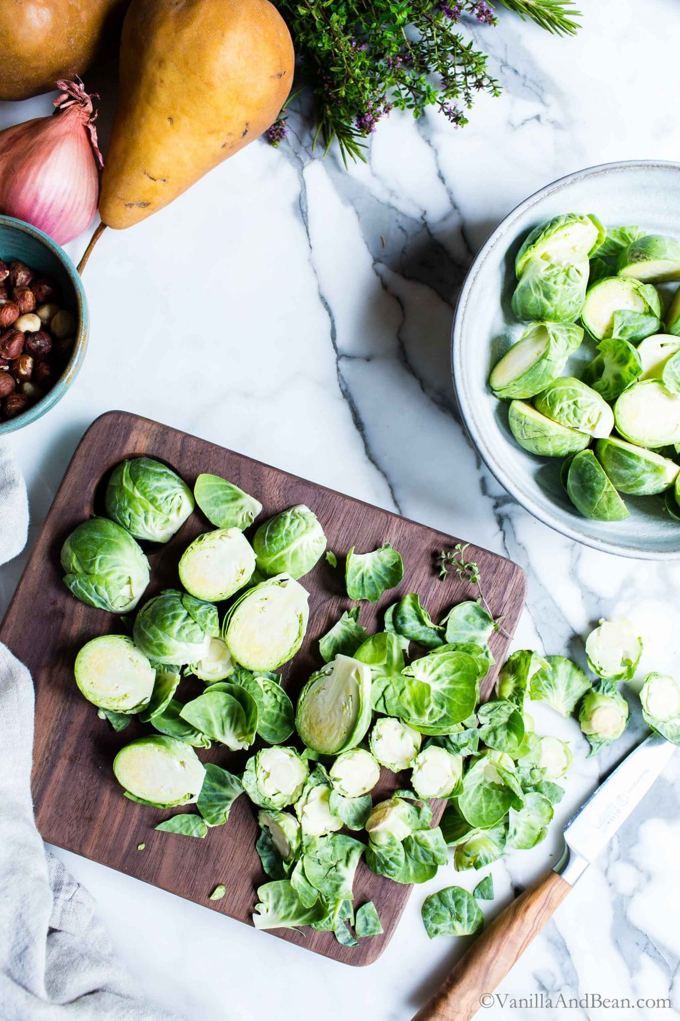 Splitting Brussels sprouts on a cutting board.