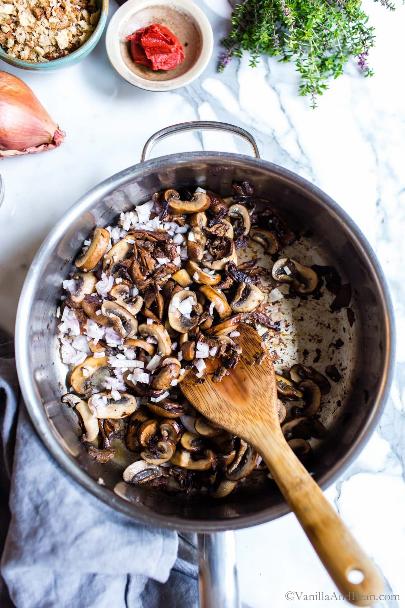 Mushrooms and shallots in a saute' pan.