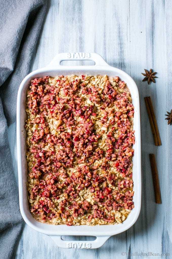 Apple Baked Oats with Cranberry Crumble in a pan.