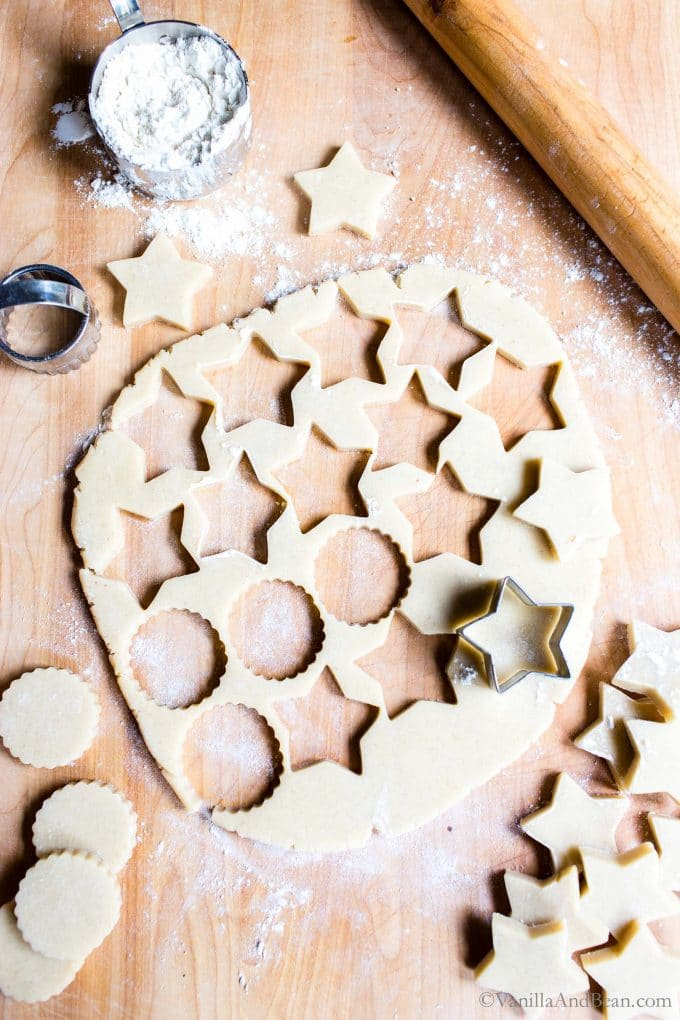 Vanilla Shortbread Cookies cut out on a cutting board.