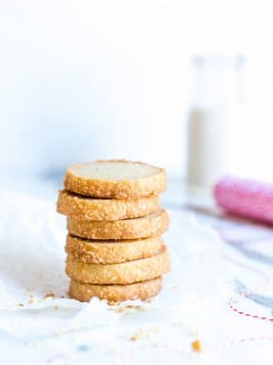 Vanilla Bean Shortbread Cookies stacked tall.