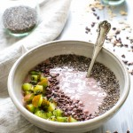 Cherry Almond Smoothie Bowl topped with kiwi, chia seeds and cocoa nibs ready for sharing.