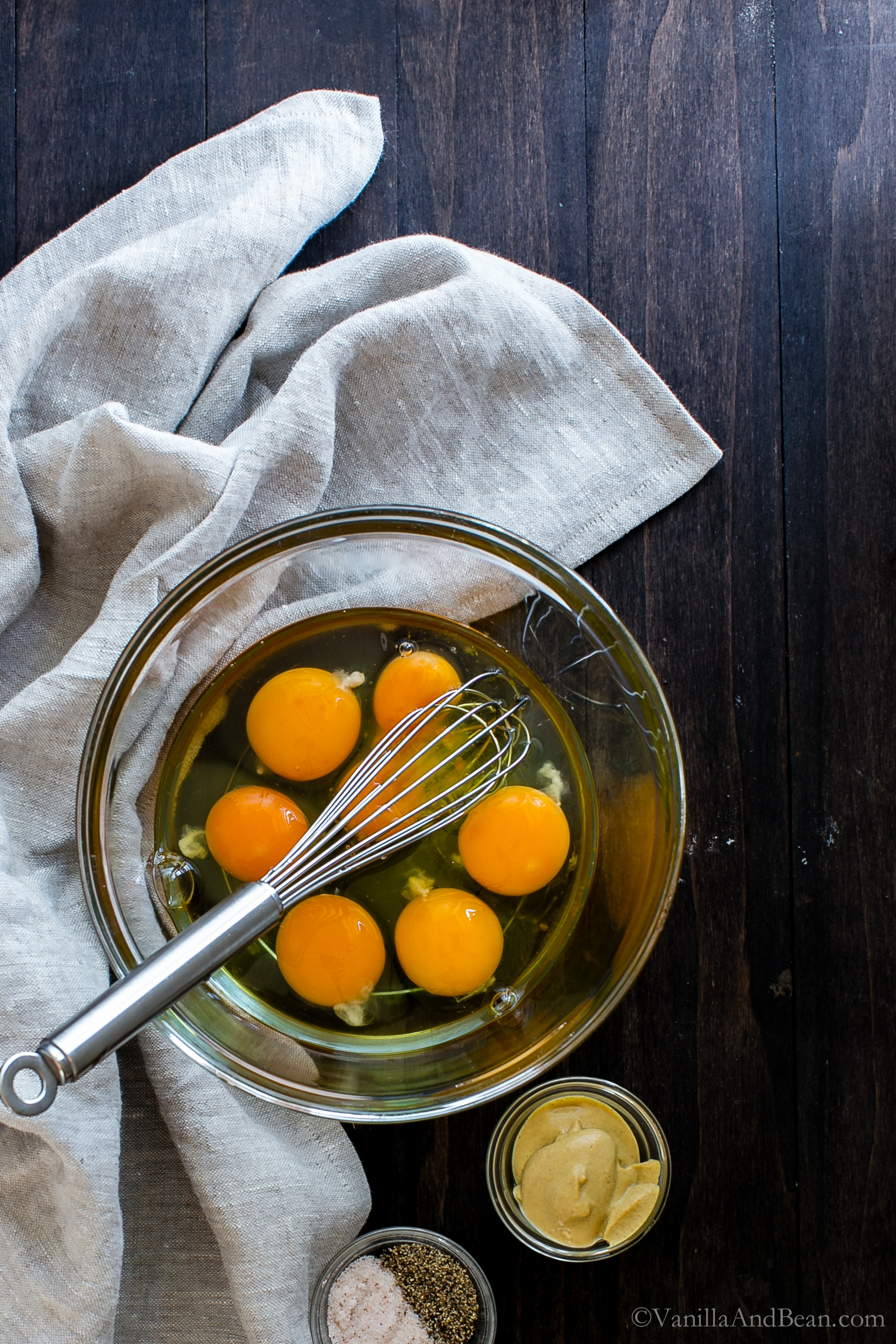 Whisking eggs in a bowl.