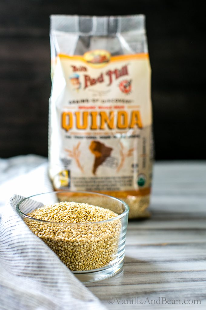 A bowl of quinoa with a bag of Bob's Red Mill quinoa in the background.