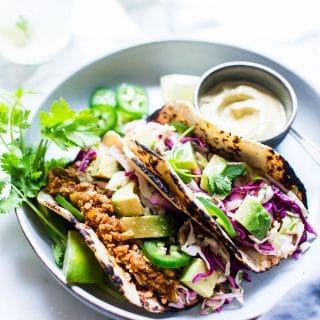 Tofu Tacos on a plate with Pumpkin Seed Cream ready to be shared.