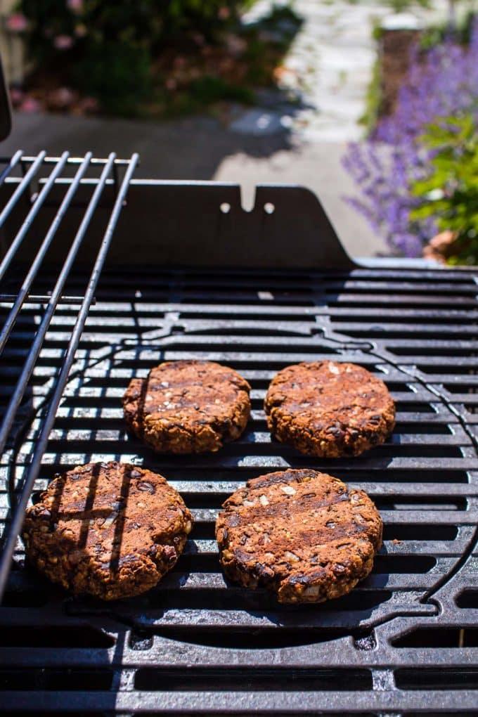 Veggie black bean walnut burgers on a grill