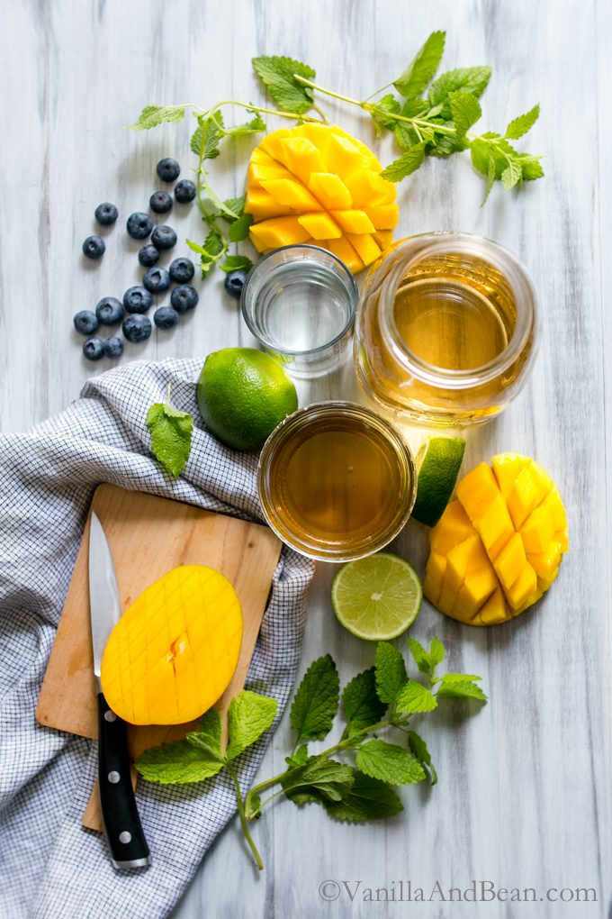 Overhead shot of ingredients for Mango Sangria