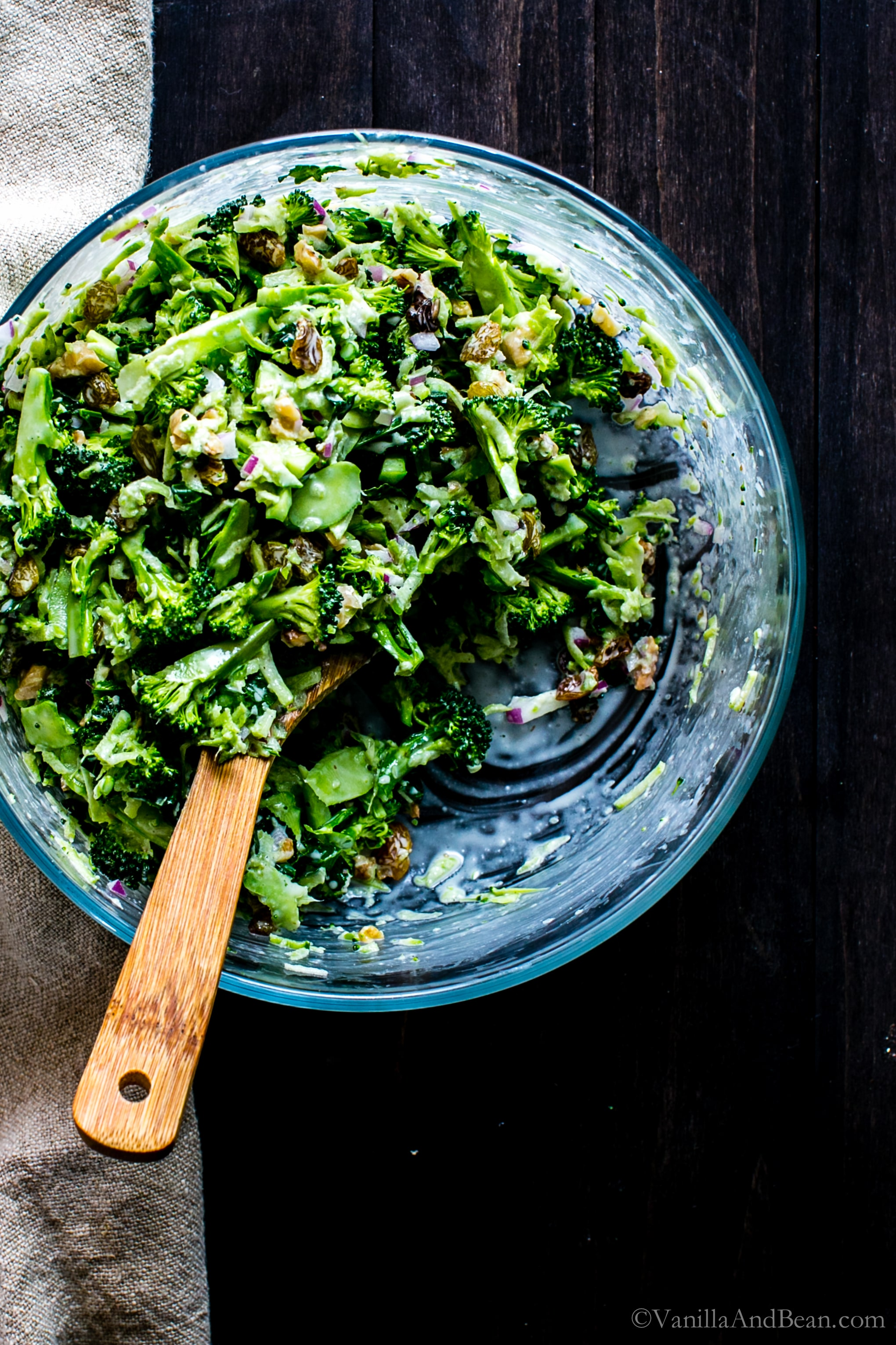 Use the entire broccoli to make this addicting Broccoli Slaw with Golden Raisins and Walnuts. Easy to whip up and have on the ready for lunch, sides or picnics! vegan or vegetarian + gluten free