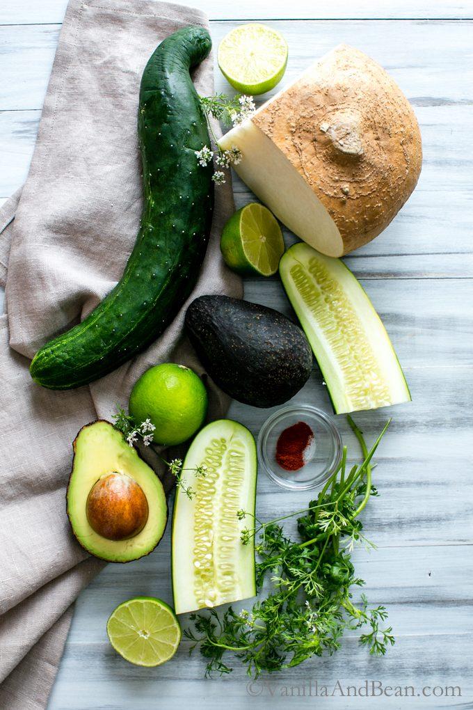 Overhead shot of ingredients for Avocado Jicama Cucumber Salad