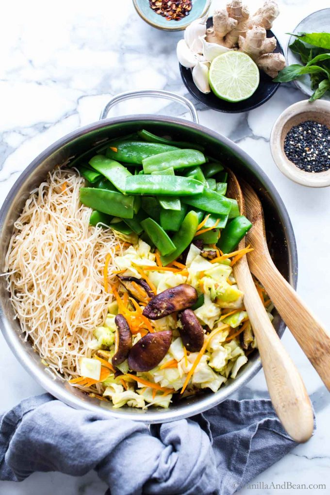 All the ingredients for the asian noodle bowl in a skillet.