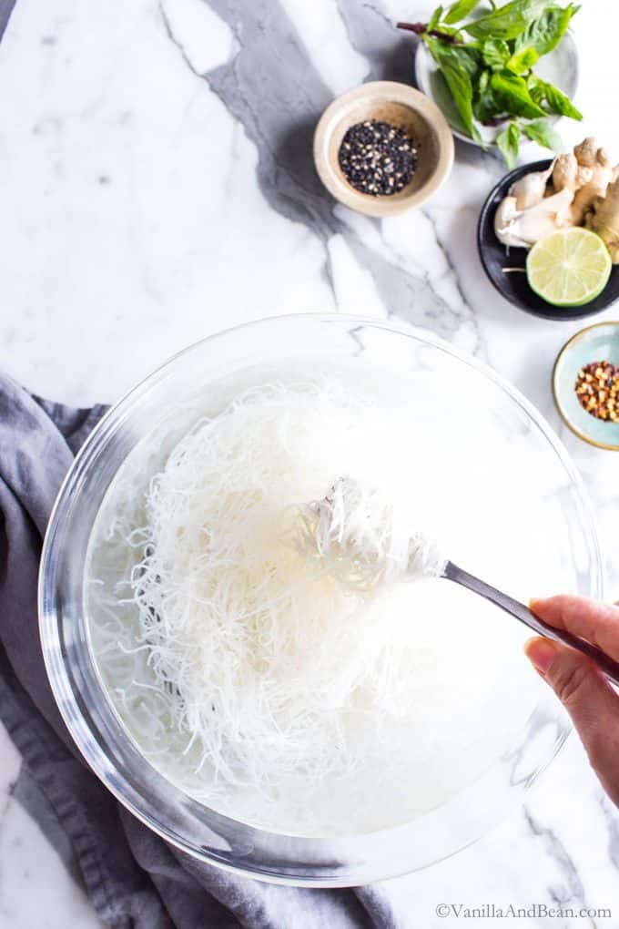 Soaking rice noodles prepping for an easy noodle bowl recipe.