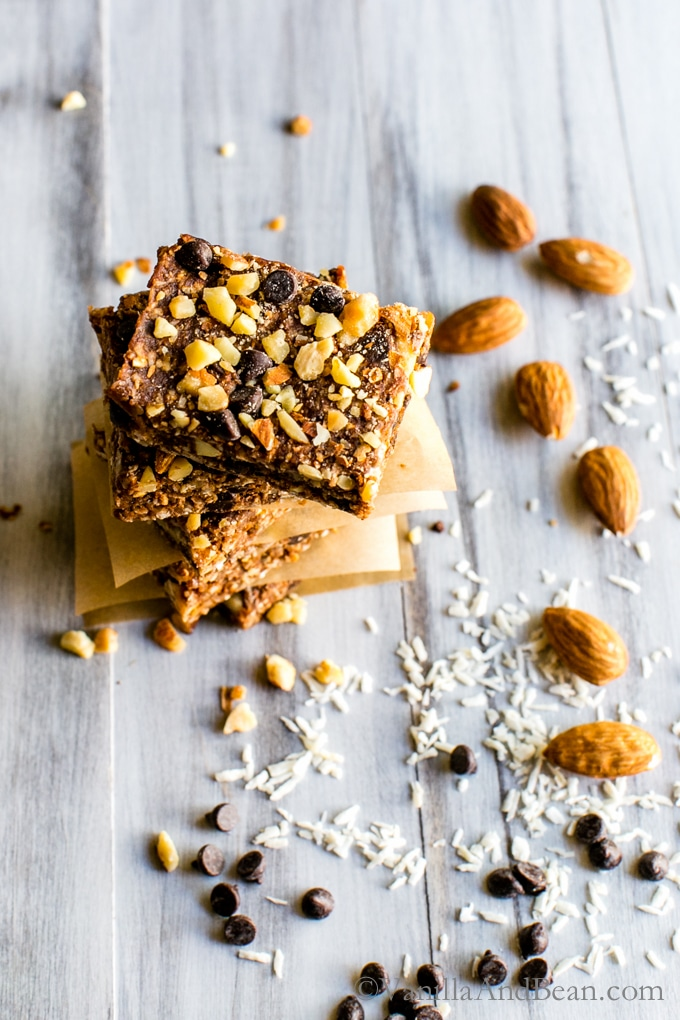 No Bake Vegan Chocolate Almond Coconut Bars stacked tall and ready for sharing.