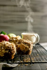 Warming and cozy Apple Gingerbread-Oat Walnut Muffins with Brown Sugar Streusel are easy to make and freezer friendly! Welcome fall! Vegan.