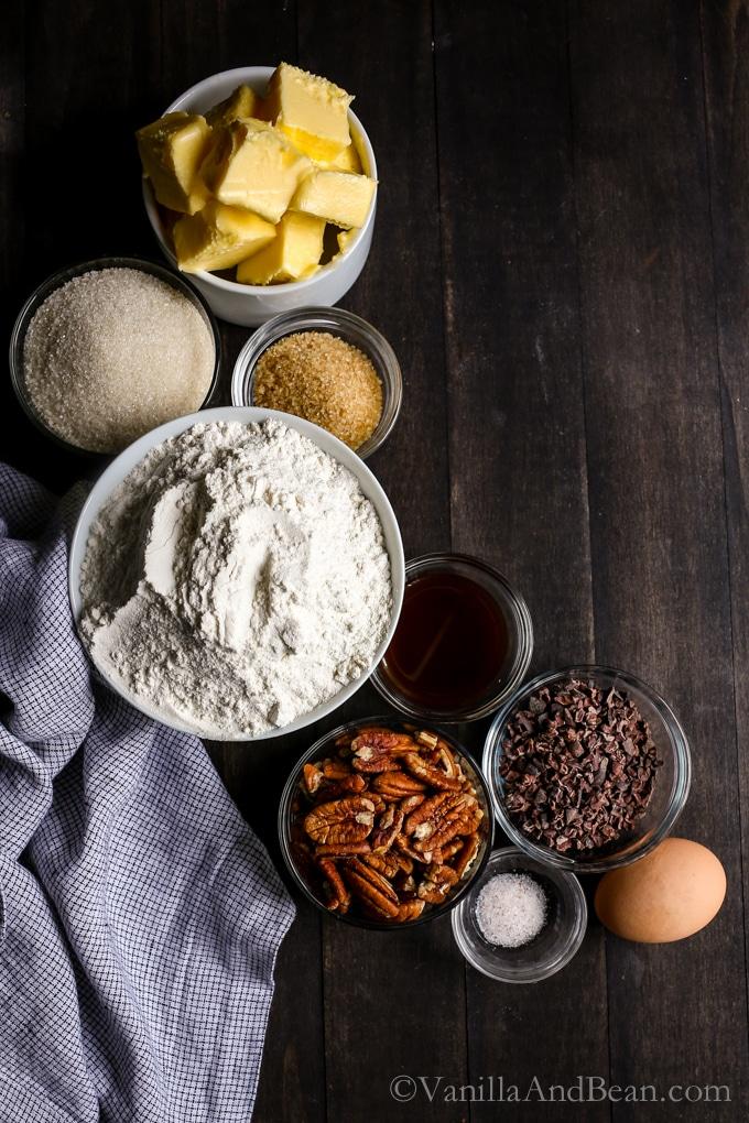 Overhead shot of Cocoa Nibby Pecan Shortbread Cookies ingredients.