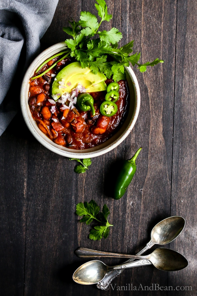 A cozy Kabocha Two Bean Chili simmered in a chipotle and poblano base with fire roasted tomatoes and warming spices. Dinner in 30 minutes and freezer friendly! Vegan + Gluten Free